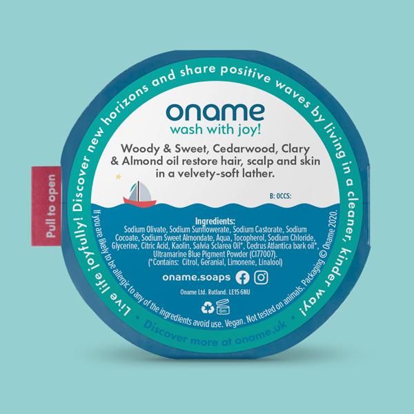 Oname Cedarwood & Clary Sage soap back view on a blue background