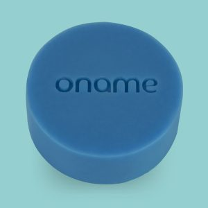 Oname Cedarwood & Clary Sage soap on a blue background