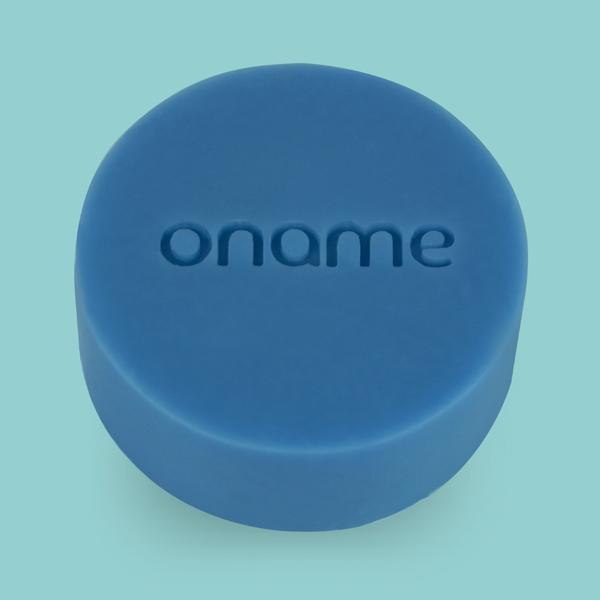 Oname Cedarwood & Clary Sage soap on a blue background