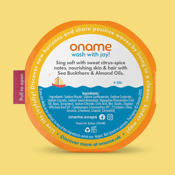 Oname Sea Buckthorn. Lemongrass & Ginger soap back view on an orange background