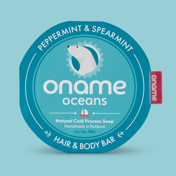 Oname naked Peppermint & Spearmint soap on a blue background