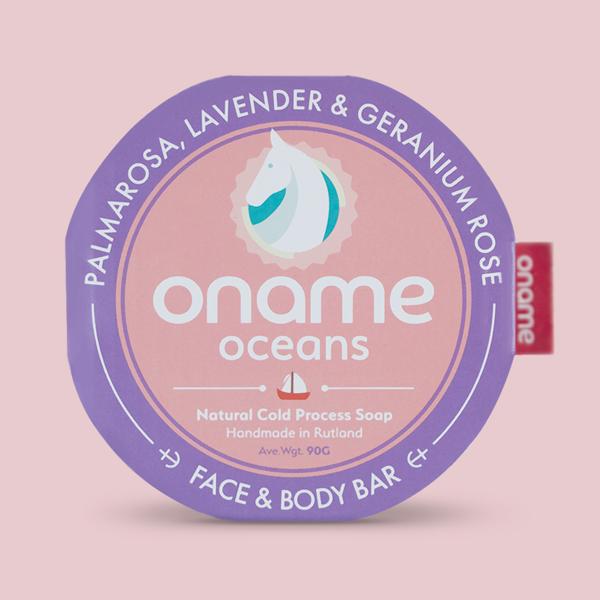 Oname Palmarosa, Lavender & Geranium Rose soap on a pink background