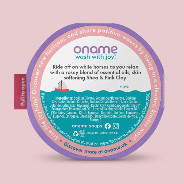 Oname Palmarosa, Lavender & Geranium Rose soap back view on a pink background