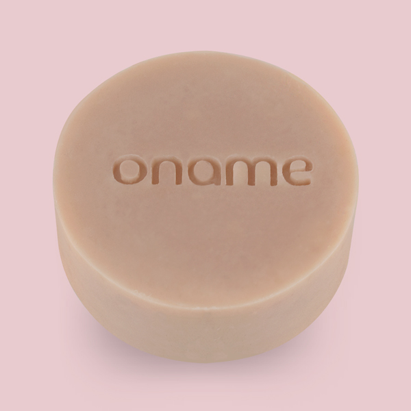 Oname Palmarosa, Lavender & Geranium Rose soap side view on a pink background