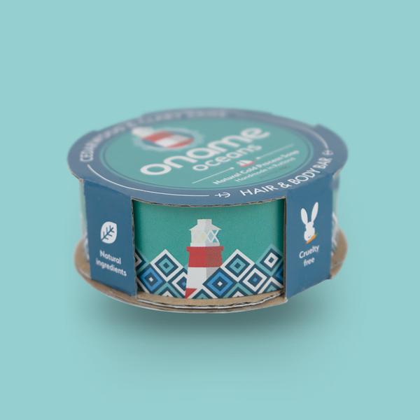 Oname Cedarwood & Clary Sage soap side view on a blue background