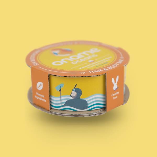 Oname Sea Buckthorn. Lemongrass & Ginger soap side view on a blue background