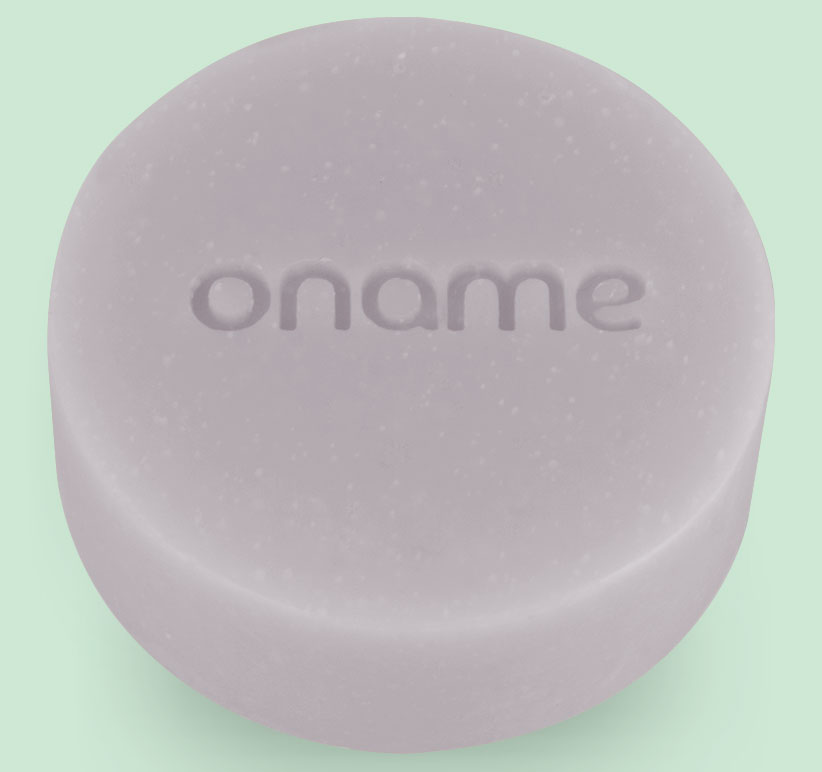 Oname Citronella & Walnut soap on grey background